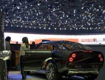 Checking out a sports car. Visitors at the Geneva Motorshow 2007 look at a sports car Royalty Free Stock Images
