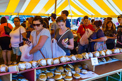 Checking Out the Whoopie Pies. Ronks, PA - September 10, 2016: Shoppers selecting a Whoopie pie from over 100 different flavors at the Whoopie Pie Festival at Stock Photos