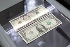 Paper money on the glass scanner. royalty free stock photo