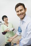 Checking Patient医生的血压 免版税库存图片