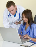 Checking the patients x-rays Stock Photography