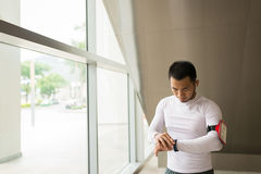 Checking pedometer Royalty Free Stock Images