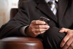Checking phone Royalty Free Stock Photos
