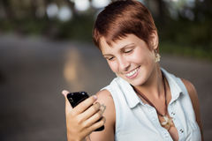 Checking phone outdoors Royalty Free Stock Photos