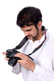 Checking Photographs Royalty Free Stock Images