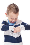 Checking pocket. Cute smiling kid checking pocket on isolated white Royalty Free Stock Photos