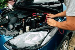 Checking power of battery by clamp meter,. Maintenance car by yoursalf, Monthly check Stock Images