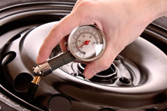 Checking pressure in tyre Stock Images
