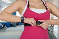 Checking pulse watch Stock Image