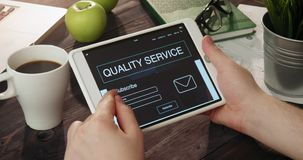 Checking quality service info using digital tablet stock video footage