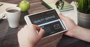 Checking quality service info using digital tablet at desk stock footage