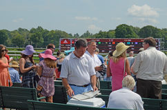 Checking the Racing Forms, Saratoga Springs, NY, Tom Wurl Stock Images