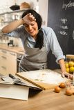 Checking recipe in cookbook. stock photography