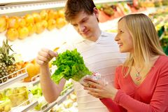 Checking salat. Portrait of man checking salat with woman looking at him Royalty Free Stock Image