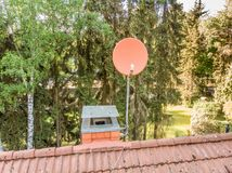 Checking the satellite dish of a house with a drone, aerial photograph, from the roof of a detached house Royalty Free Stock Images