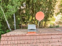 Checking the satellite dish of a house with a drone, aerial photograph, from the roof of a detached house Royalty Free Stock Photo