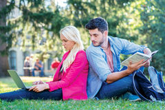 Checking a school assignment. Girl-student and male student hold Stock Photo