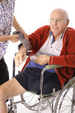 Checking senior citizens blood pressure Stock Photo