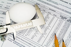 Checking the size of the nest egg. Measuring the size of the nest egg with 401K financials Stock Photos
