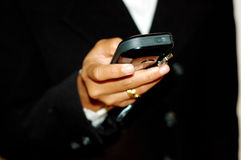 Checking SMS. Corporate women checking mobile SMS royalty free stock photo