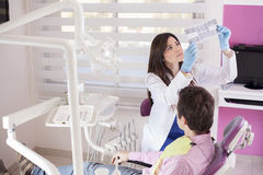 Checking some x-rays at work Stock Image