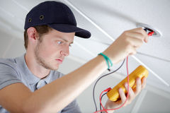 Checking source electricity Royalty Free Stock Photo