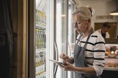 Checking Stock in the Fridge stock images