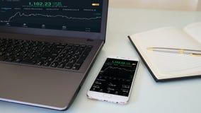 Checking stock market on mobile Stock Photos