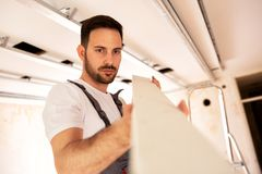 Checking the surface smoothness of a ceiling element stock photo