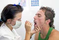 Checking throat Stock Photo