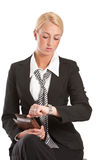 Checking the time. Businesswoman sitting and waiting while checking her watch Royalty Free Stock Images