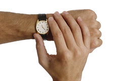 Checking the time. Mans hands checking the time on his wrist watch, isolated Stock Photo