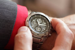 Checking the time Royalty Free Stock Photos