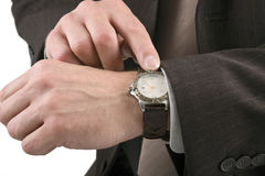 Checking the time. Businessman checking the time on his wrist watch Royalty Free Stock Image