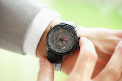 Checking the time Stock Photography