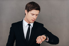 Checking the time. Stock Image
