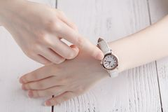 Checking time, female wrist watch on hand Royalty Free Stock Photos