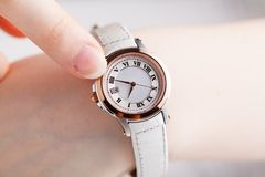 Checking time, female wrist watch on hand Royalty Free Stock Photo