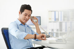 Checking the time with foreign partner Stock Photo