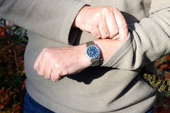 Checking the time on a watch. Royalty Free Stock Photos