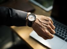 Checking time on wrist watch  Royalty Free Stock Photo