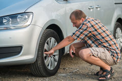 Checking tire Stock Images