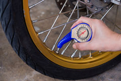 Checking tire air Stock Image