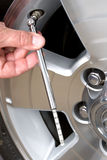 Checking tire pressure Stock Photos