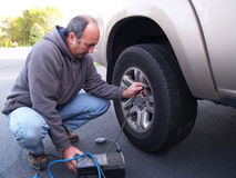 Checking tire pressure Stock Images