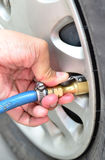 Checking Tire Pressure Royalty Free Stock Photos