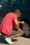 Checking the tyre Royalty Free Stock Photos
