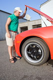 Checking Under the Hood Royalty Free Stock Photo