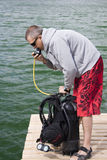 Checking up scuba gear. Preparing for dive, check up scuba gear Royalty Free Stock Photo