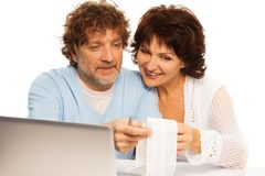 Checking up on shopping bill Stock Images